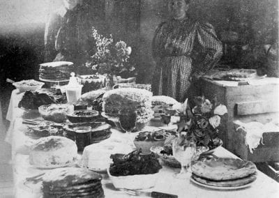 "Table set in honor of Mary ""Mate"" Kelly Phillip's 50th birthday, near Hindsville, Arkansas, April 1909."
