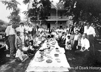 Dinner on the ground, Joseph H. Moore residence, Cane Hill, Arkansas, circa 1910.