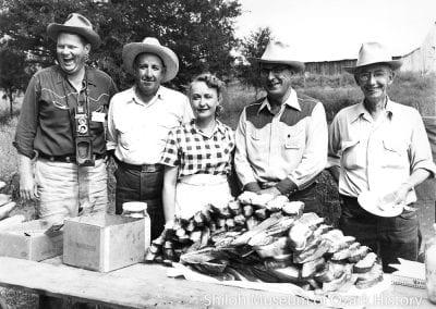 Preparing cheese bread, Rogers Riding Club, Northwest Arkansas Cavalcade trail ride, 1950s.
