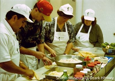 Rolling tamales, La Familia Restaurant, Fayetteville, Arkansas, November 1995.