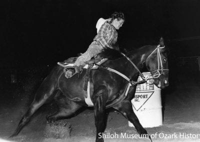 Barrel racer, 29th annual Springdale Junior Rodeo, Parson's Stadium, Springdale, Arkansas, July 19, 1990.