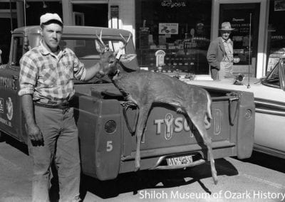 Ralph Blythe with his hunting prize near Joyce's Drug Store, Emma Avenue, Springdale, Arkansas, November 1958.