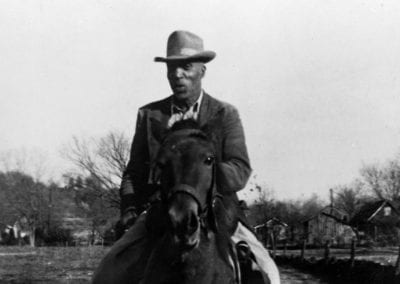 Otis J. Parker in his pasture on Willow Street, Fayetteville, Arkansas, 1957.