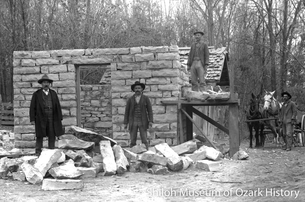 Dr. Alonzo E. Quinn (left) and stonemasons, Grandview, Arkansas, 1890s.
