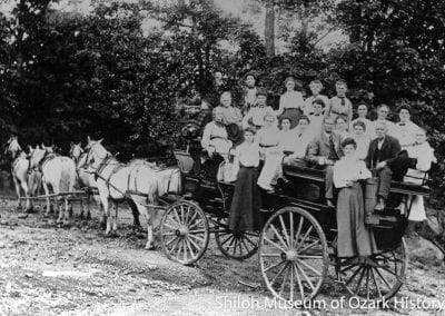 Talley Ho carriage riders on a pleasure trip, Eureka Springs, Arkansas, circa 1900.