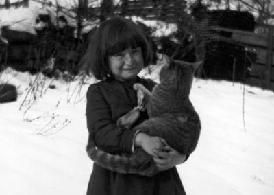 Elva Barker with her cat, Pettigrew, Arkansas, early 1920s.