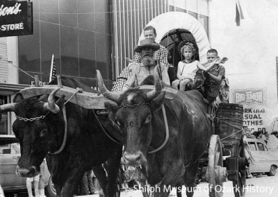 Ox-drawn wagon in the Rodeo of the Ozarks parade, Springdale, Arkansas, probably 1960s.