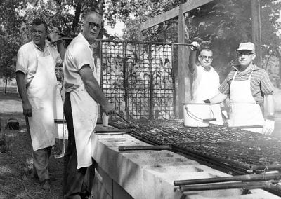 Members of the Prairie Grove Lions Club barbecuing chicken at the Prairie Grove Reunion and Clothesline Fair, Prairie Grove, Arkansas, September 6, 1965