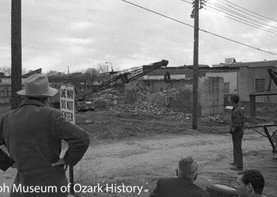 Tearing down the old First State Bank vault as part of urban renewal, Springdale, AR, February 16, 1971.
