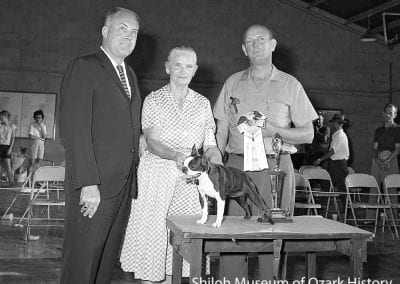 "Ruth Dilly with her Boston terrier, ""Ima Dilley's Abigail,"" Best in Match winner, Northwest Arkansas Kennel Club show, Springdale, Arkansas, June 14, 1964."