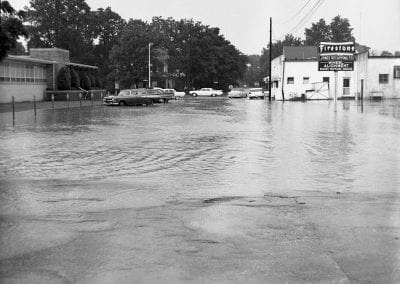 Flooding in downtown Springdale, AR, looking west from Shiloh Street, June 1965.