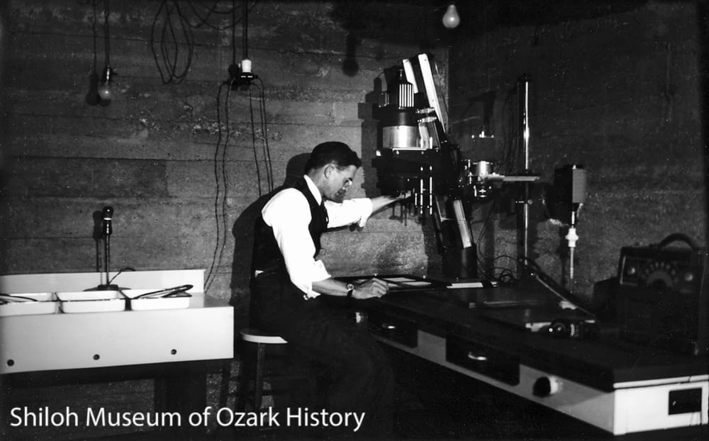 Carl Smith in his home darkroom, Fayetteville, 1930s.