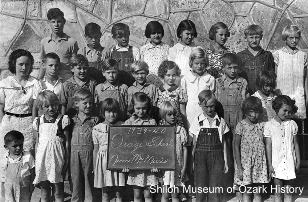 Osage Elementary School students with teacher Naomi McMorris (middle row, far left), 1939-1940.