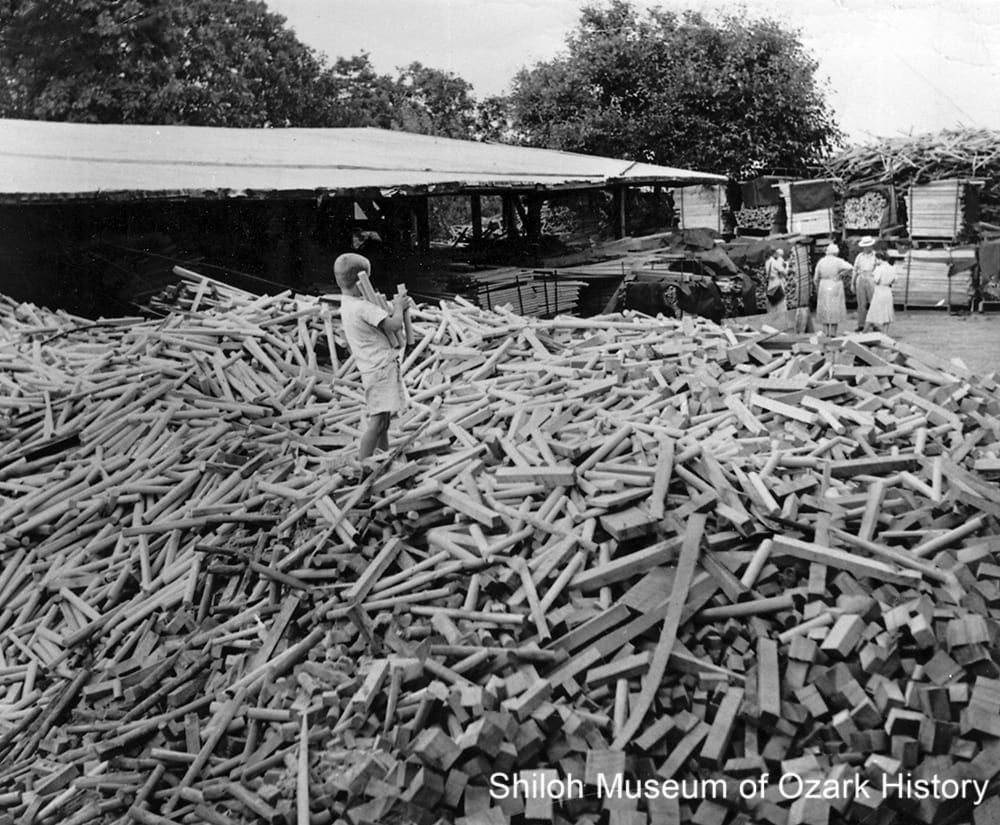 Lumber pile at I. C. Sutton Handle Factory, Harrison (Boone County, Arkansas), 1950s.