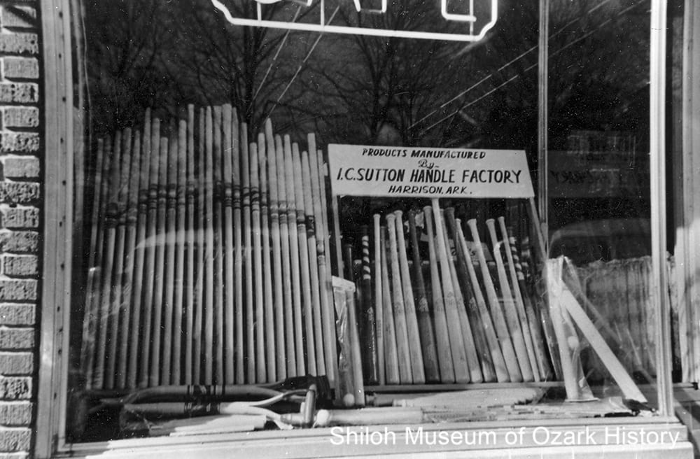 I. C. Sutton Handle Factory's display of shovel and hoe handles and baseball bats, Harrison (Boone County), 1950s.