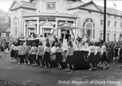 University of Arkansas homecoming parade, First Baptist Church, corner of College Avenue and Dickson Street, Fayetteville, about 1940.