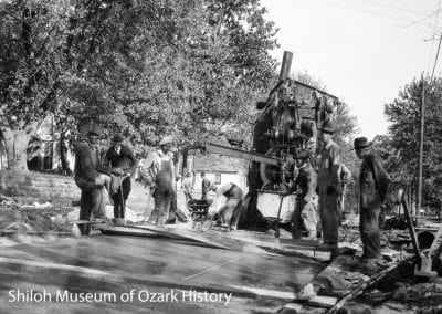 Spreading concrete, Mountain Street district, Fayetteville, September 1925. Carl Smith is standing second from left.