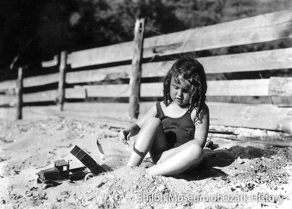 Ada Lee Smith in her sandbox, Fayetteville, 1933.
