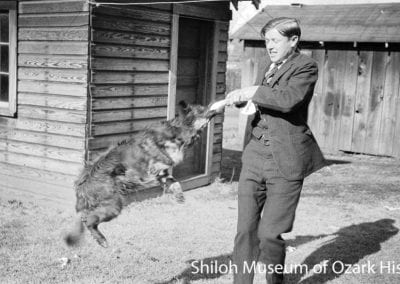 Frank Smith with his brother Carl's dog, Static, Fayetteville, 1920s