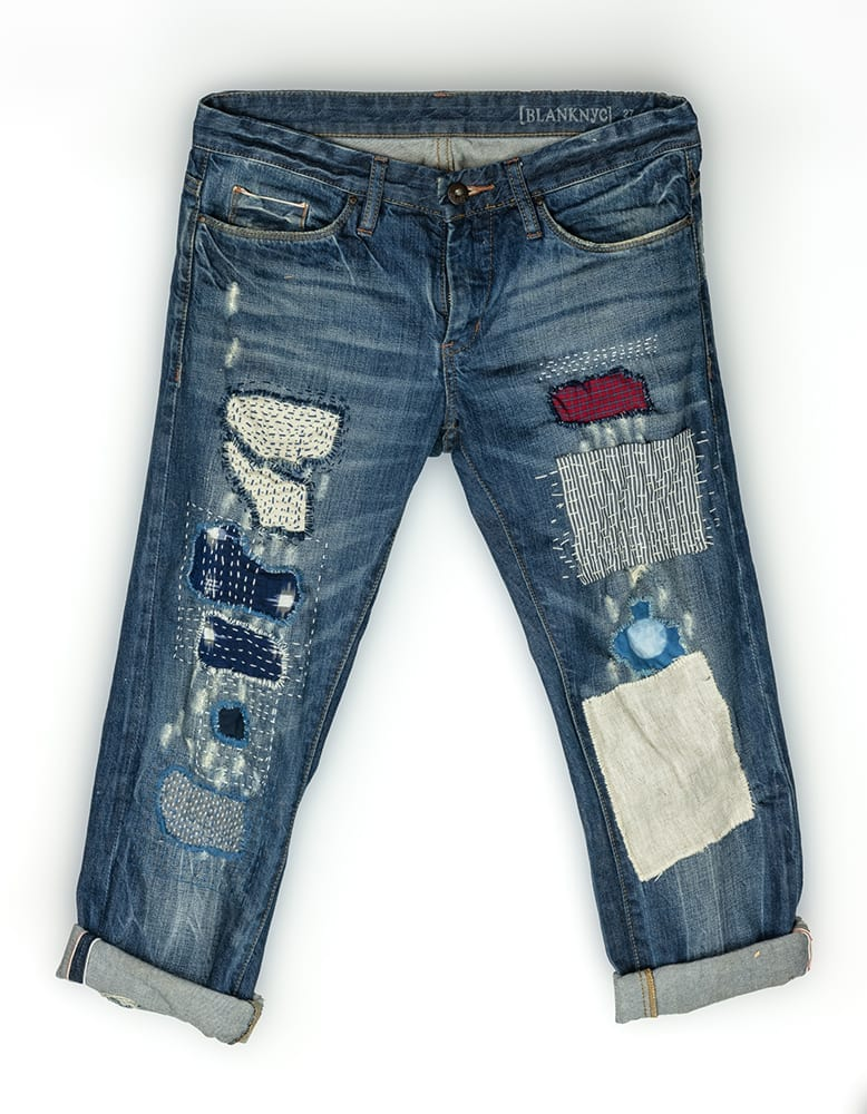 Jeans mended with a centuries-old decorative Japanese stitching method known as sashiko (