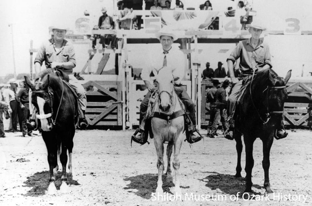 "Early rodeo leaders, Parsons Stadium, Springdale, July 1946.  From left: Walter Watkins, Evert Head, B.B. ""Cap"" Brogdon (1946 parade marshal)."