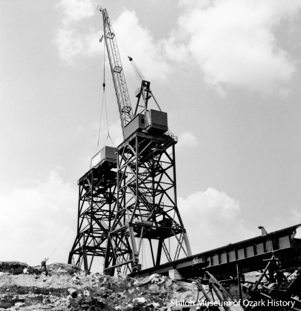 A whirley crane places a second crane, June 1961.