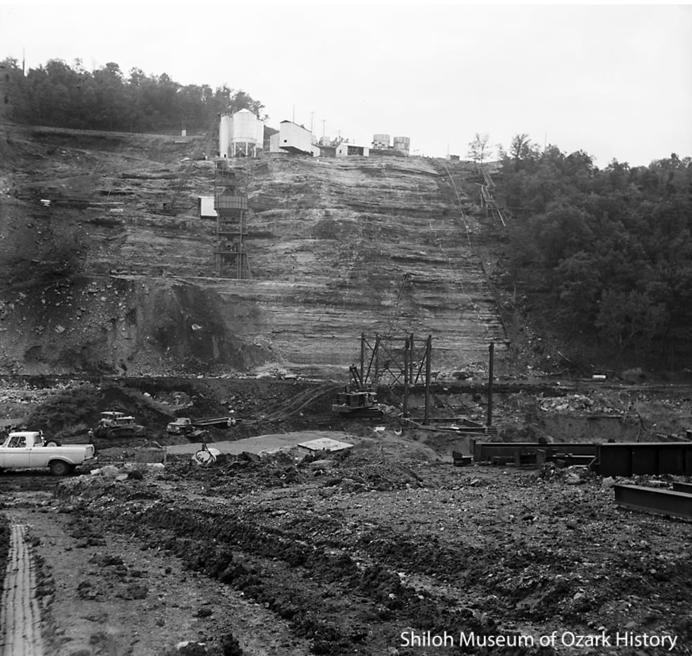 Bluff with the trestle and mixing plant under construction, June 1961.