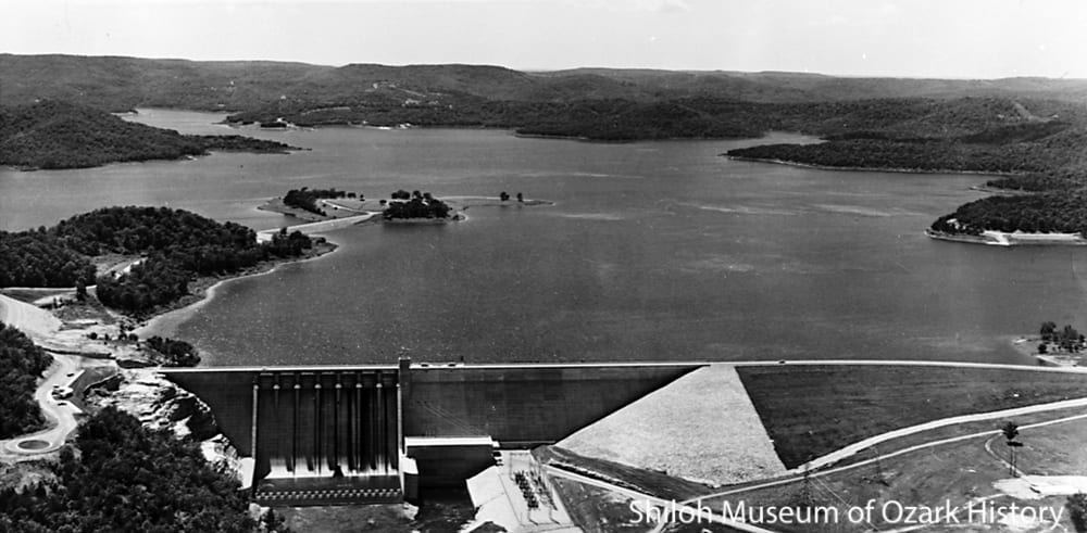 The completed dam and Beaver Lake, circa 1966.  The switchyard is seen to the right of the spillway and powerhouse.