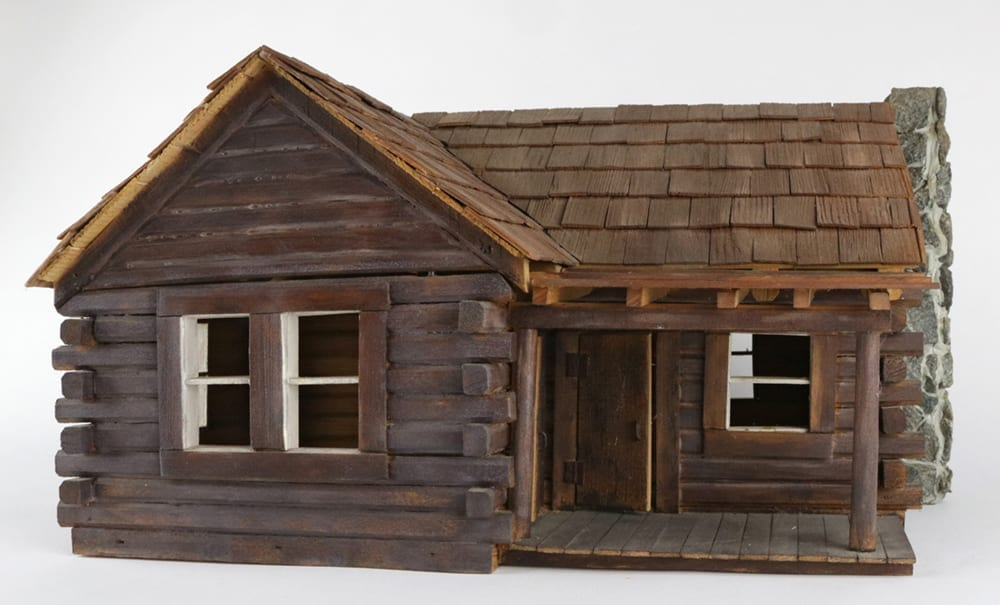 a replica of the Albert and and Ida Beadle log cabin located on Highway 71 south of Greenland. It was made by Rusty Lanham in 1999.