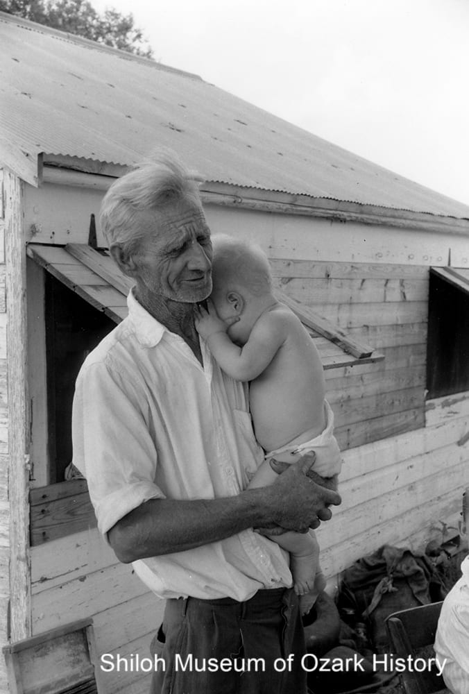 Omer Bynum with his granddaughter Rhonda Walton, 1957.