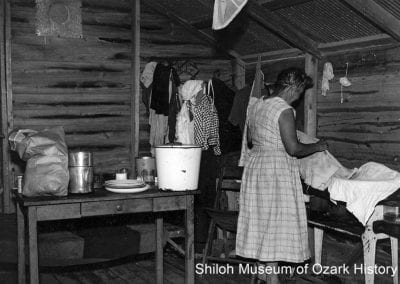 Frances Lee Bynum in her cabin, Springdale, August 1957.