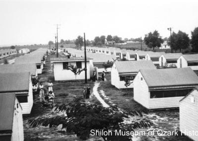 Cabins surrounding one of four toilet facilities, Springdale, about 1945.