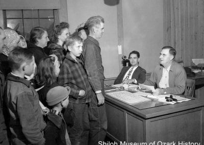 Labor camp office, Springdale, mid 1940s. Denver Misenhimer, director (at desk.