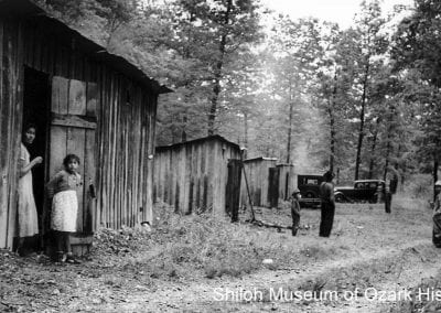 Native American strawberry pickers (probably Cherokee) in farm shelters, Springdale area, 1939.