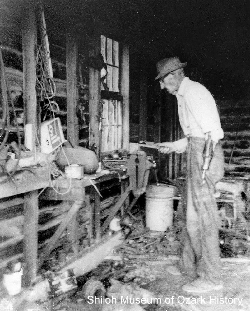 Burton C. Hull in his blacksmith shop at the B.C. Hull Lumber Company, Eureka Springs (Carroll County), 1967.
