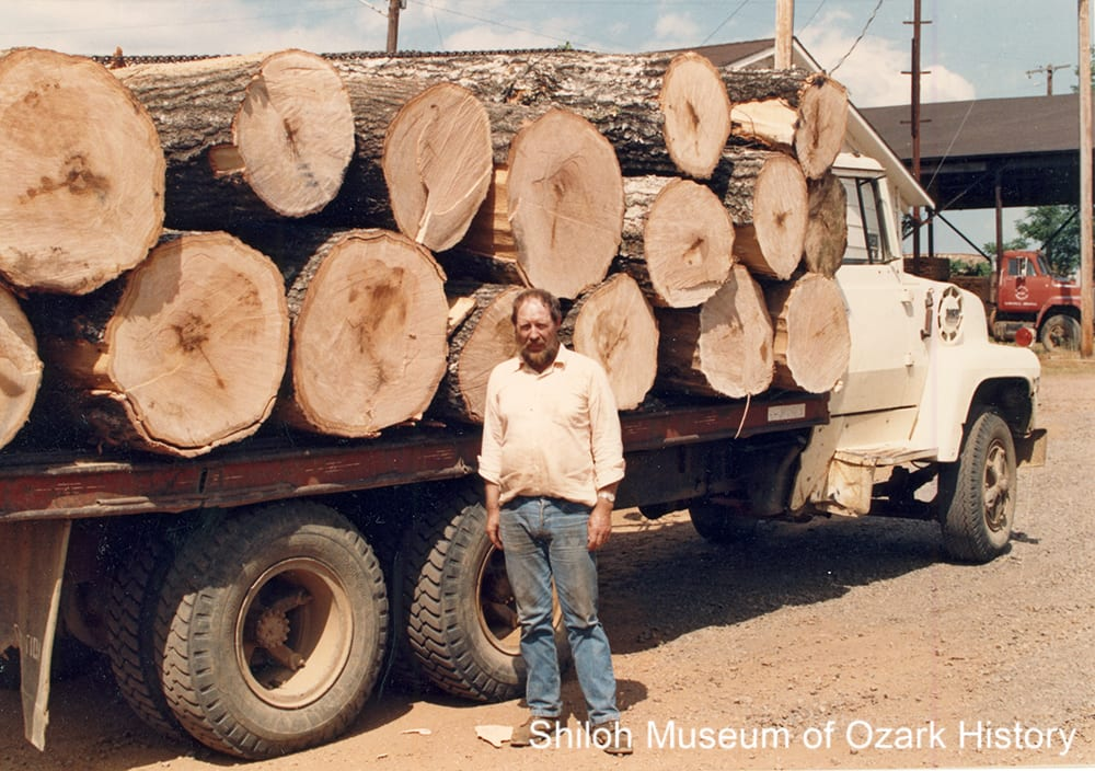 Wayne Martin with his log truck, Pettigrew(Madison County, Arkansas), circa 1988.