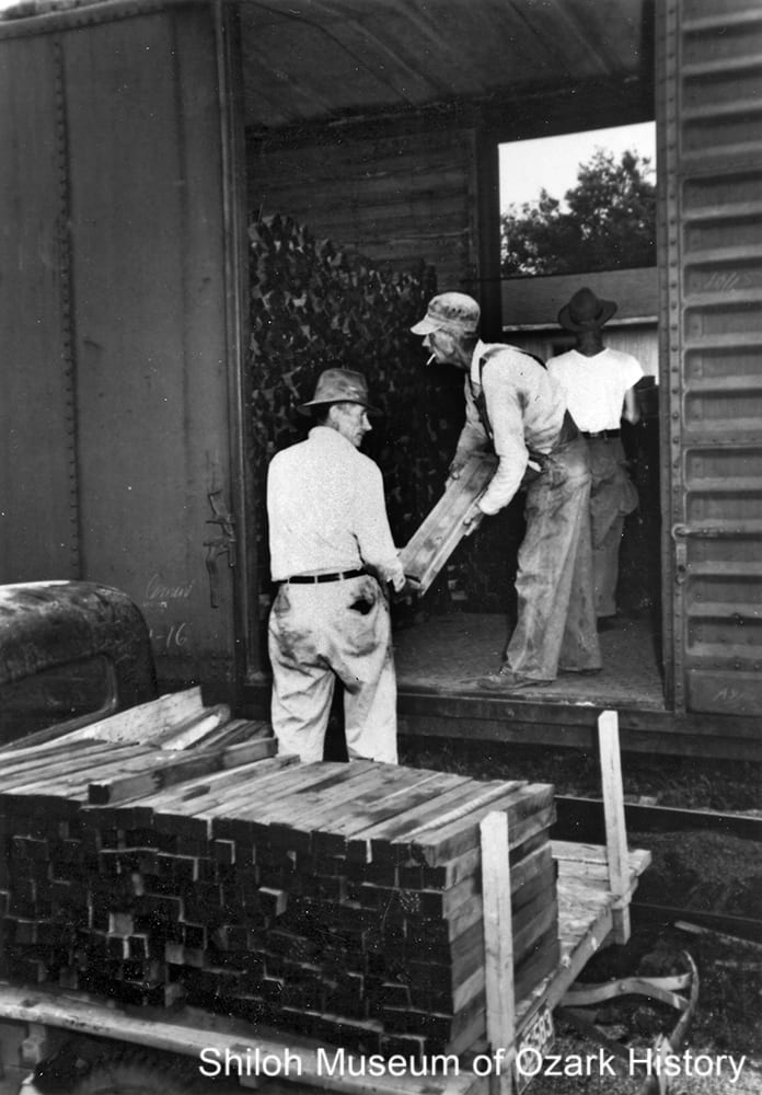 Loading walnut gunstock blanks into a railroad car at the Carl Erwin sawmill, Harrison, Arkansas, circa 1950.