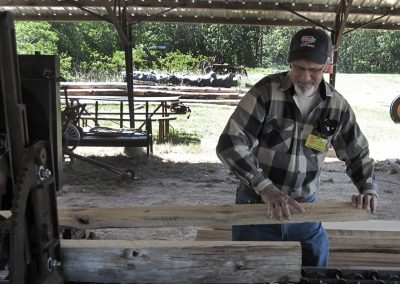 Sawmill off-bearer removing a board