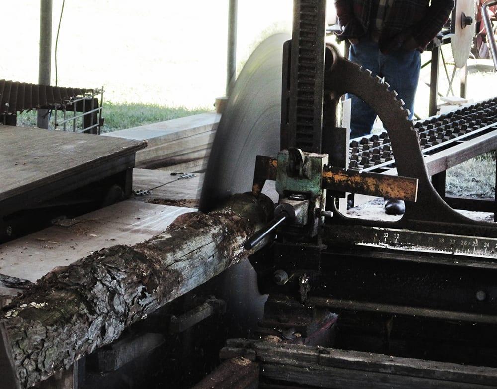 Sawmill blade cutting log