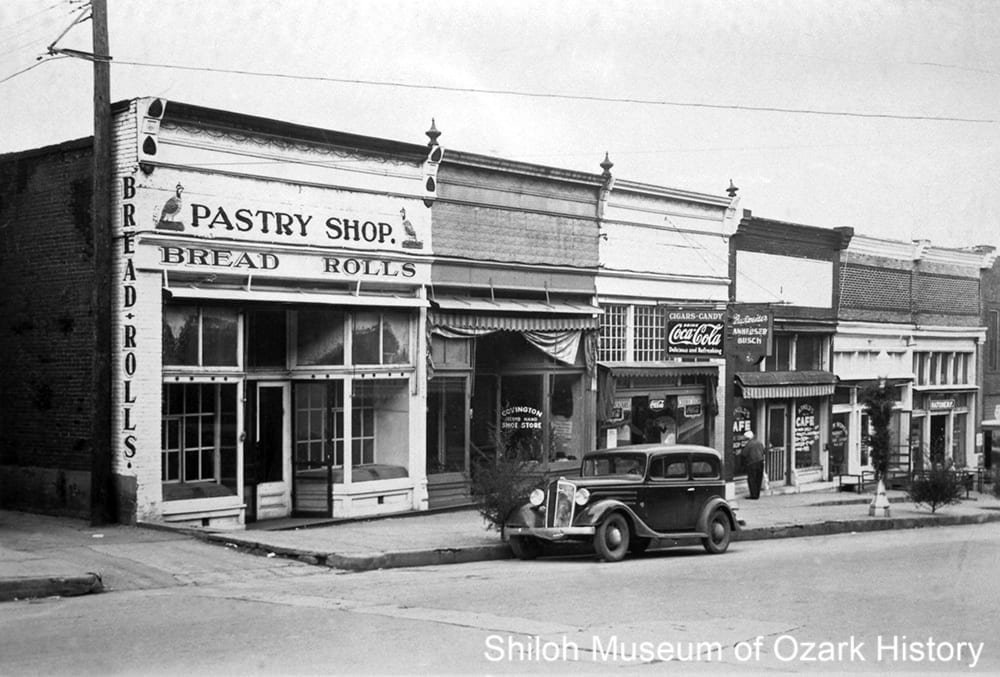 Steve Georgenis' candy kitchen, third storefront from the left, North Block Avenue, Fayetteville, about 1934.
