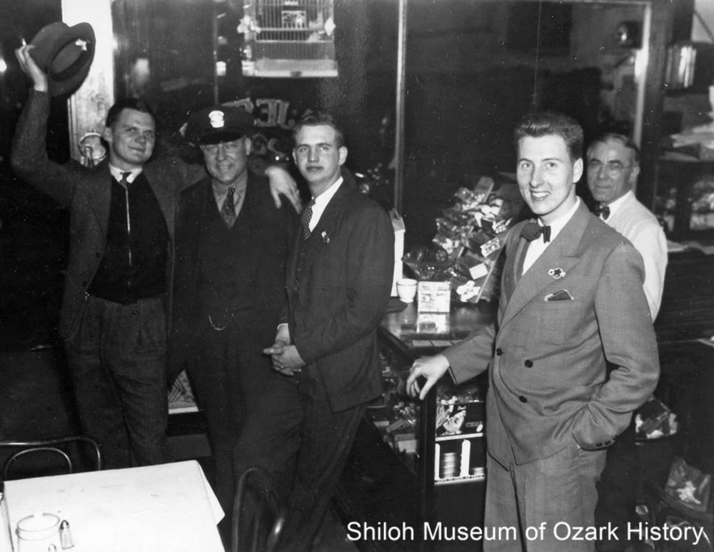 George Pappas (far right) at the Majestic Café, Dickson Street, Fayetteville, 1930s. With University of Arkansas students and Fayetteville patrolman, Theo Burms.