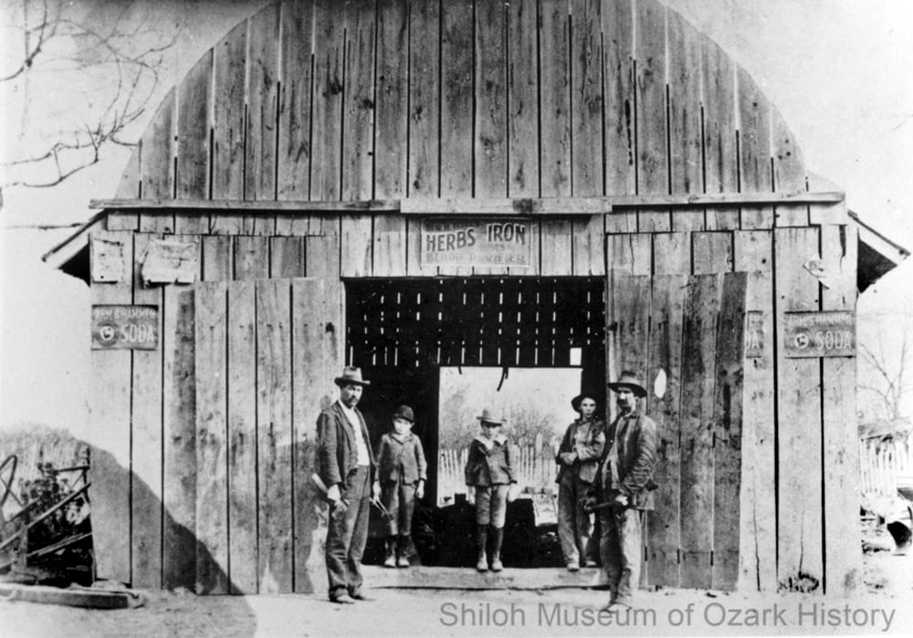 Sam Paul's blacksmith shop, Gaither, Boone County, Arkansas, circa 1902.
