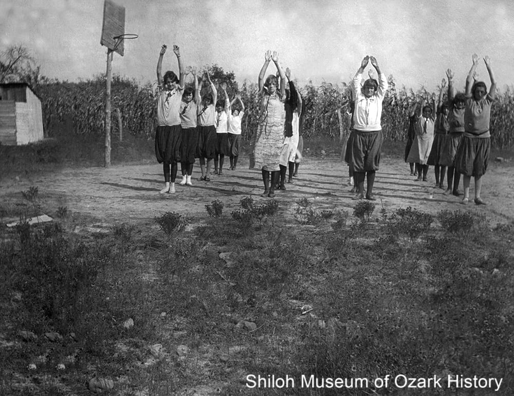 Kingston High School students exercising on the basketball court, Madison County, Arkansas,mid 1920s.