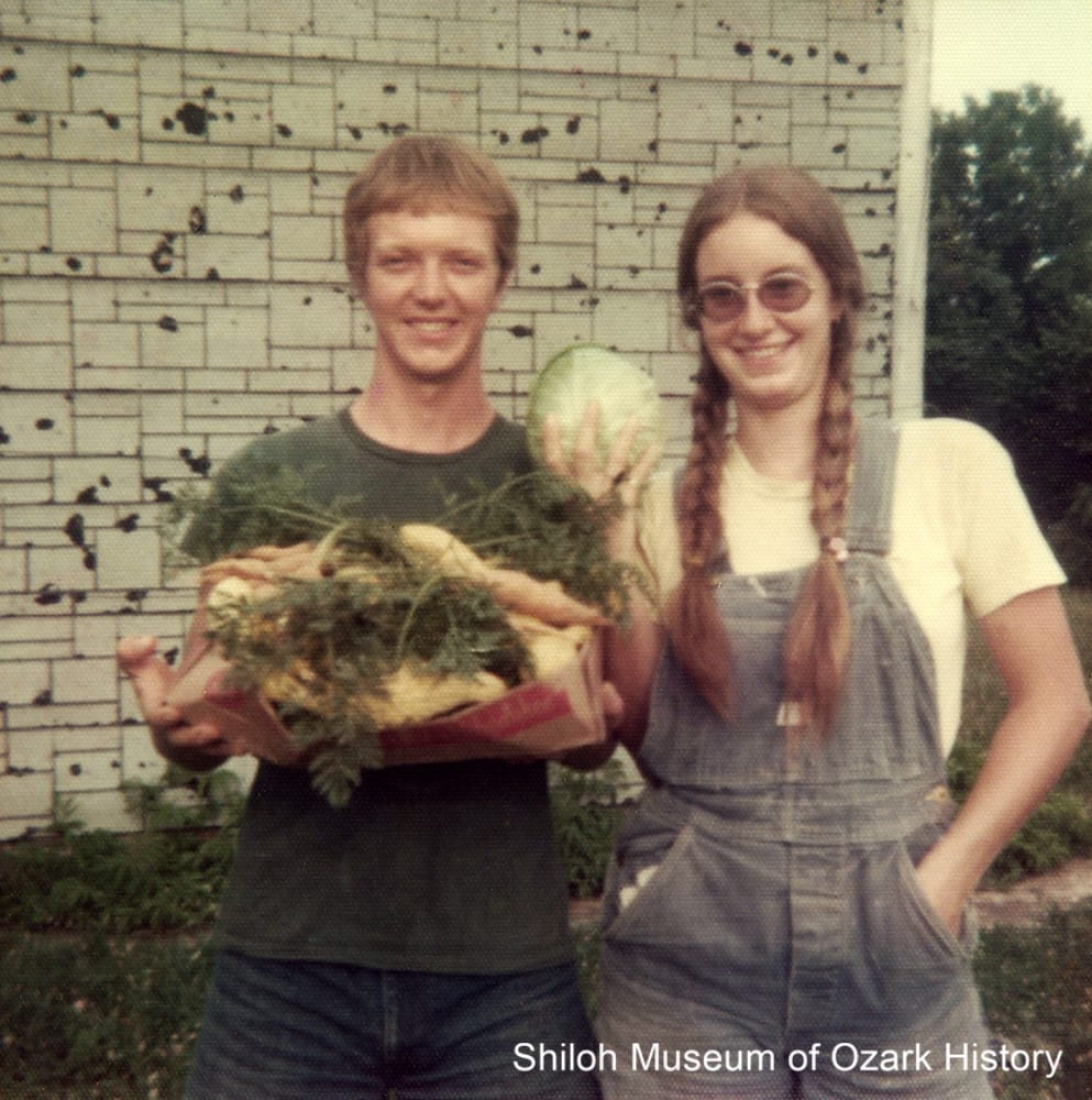 Gary Davidson and Cindy Cadwallader Davidson Arsaga with their homegrown vegetables at Glen Haught's home, Witter, Arkansas, 1974.