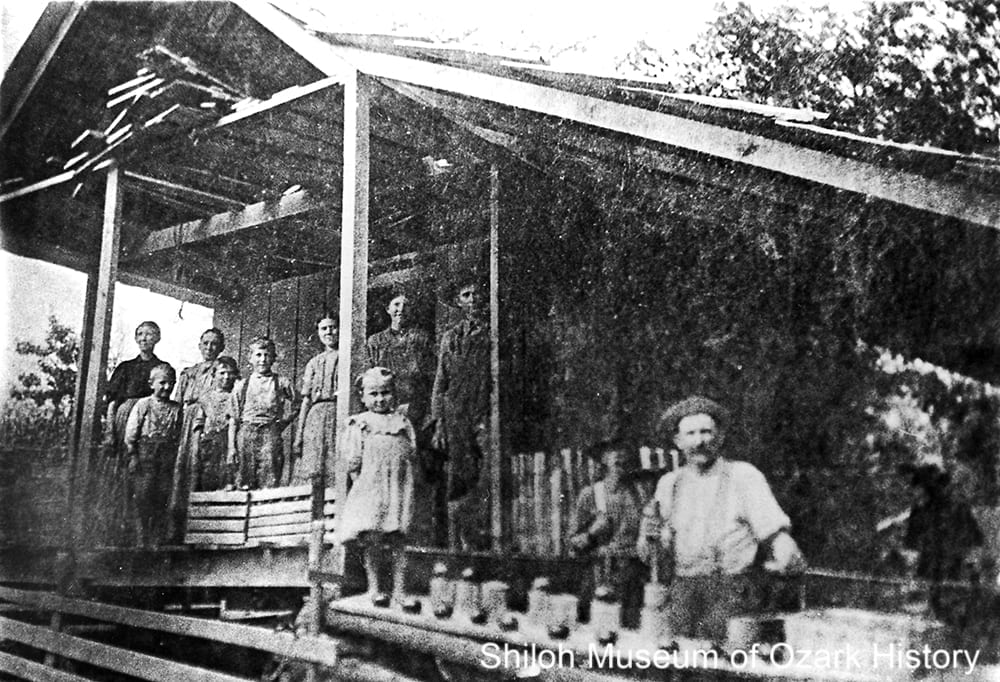 Joe Cowell and family at their cannery, near Deer, Newton County, Arkansas,1900s.