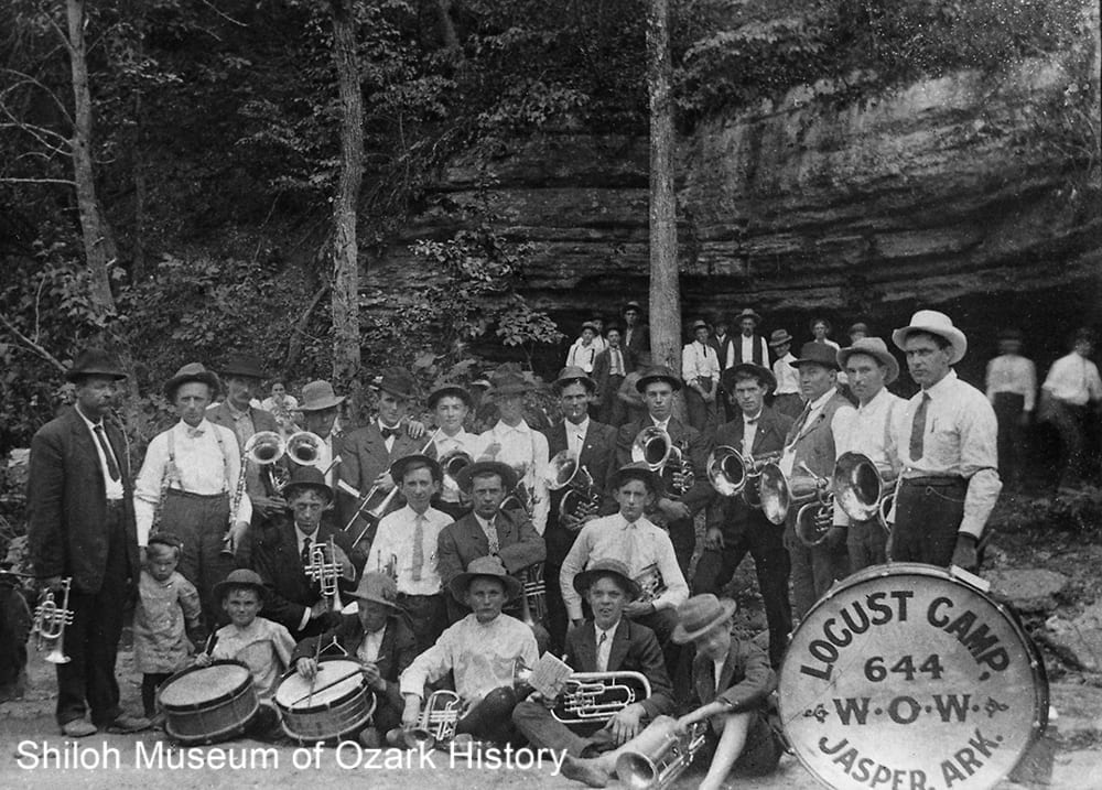 James Braswell (far left) with members of the Jasper and Parthenon bands playing at a spring picnic, Diamond Cave, near Jasper, Newton County, Arkansas,about 1910.