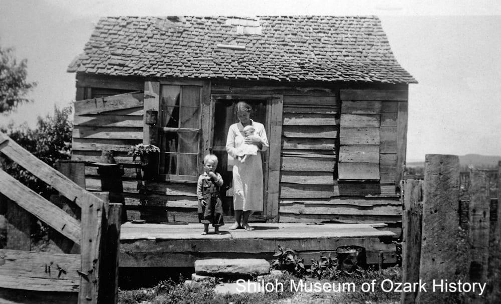 Mrs. Garrett Jones and children at their home, Newton County, Arkansas, 1933-1935.
