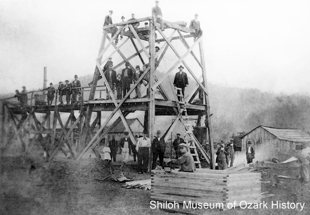 Carl Wright (near top of ladder) at his gold mine, Combs, Arkansas,1918.