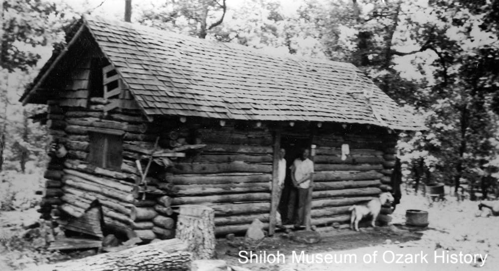 Ted Richmond (right) at the Wilderness Library, Mount Sherman, Newton County, Arkansas,1940s-1950s.