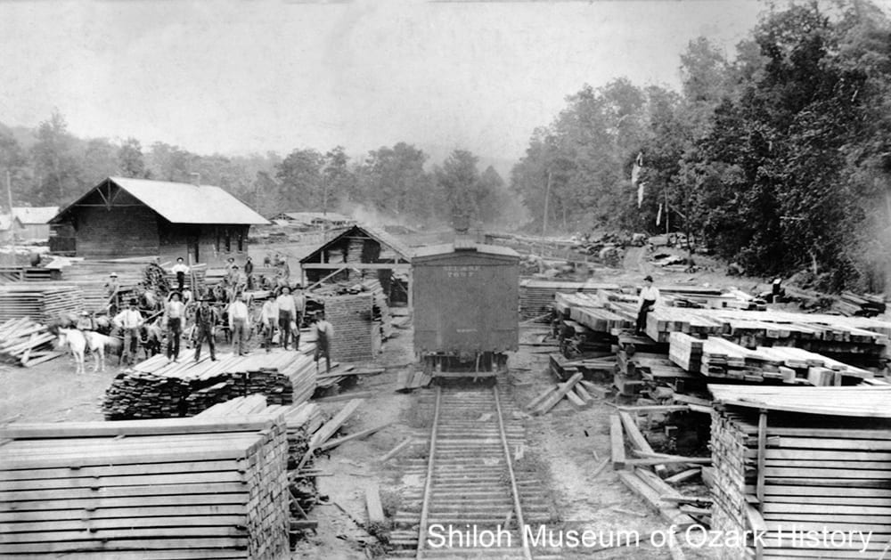 St. Louis and San Francisco Railroad car at the Yount Stave Mill near the Frisco depot (far left), Pettigrew, Arkansas, 1900s.